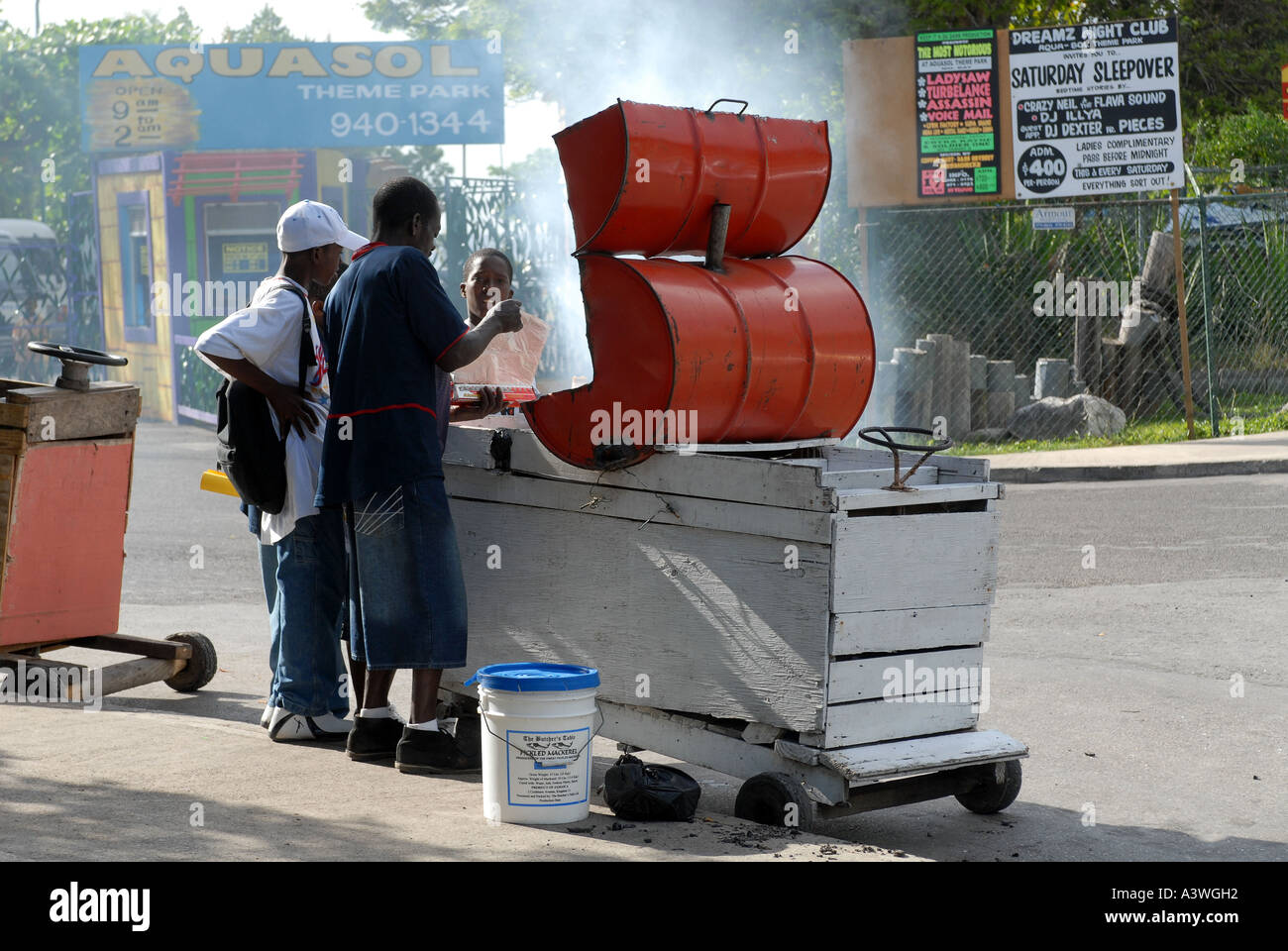 Jerk chicken seller Montego Bay Jamaica Stock Photo