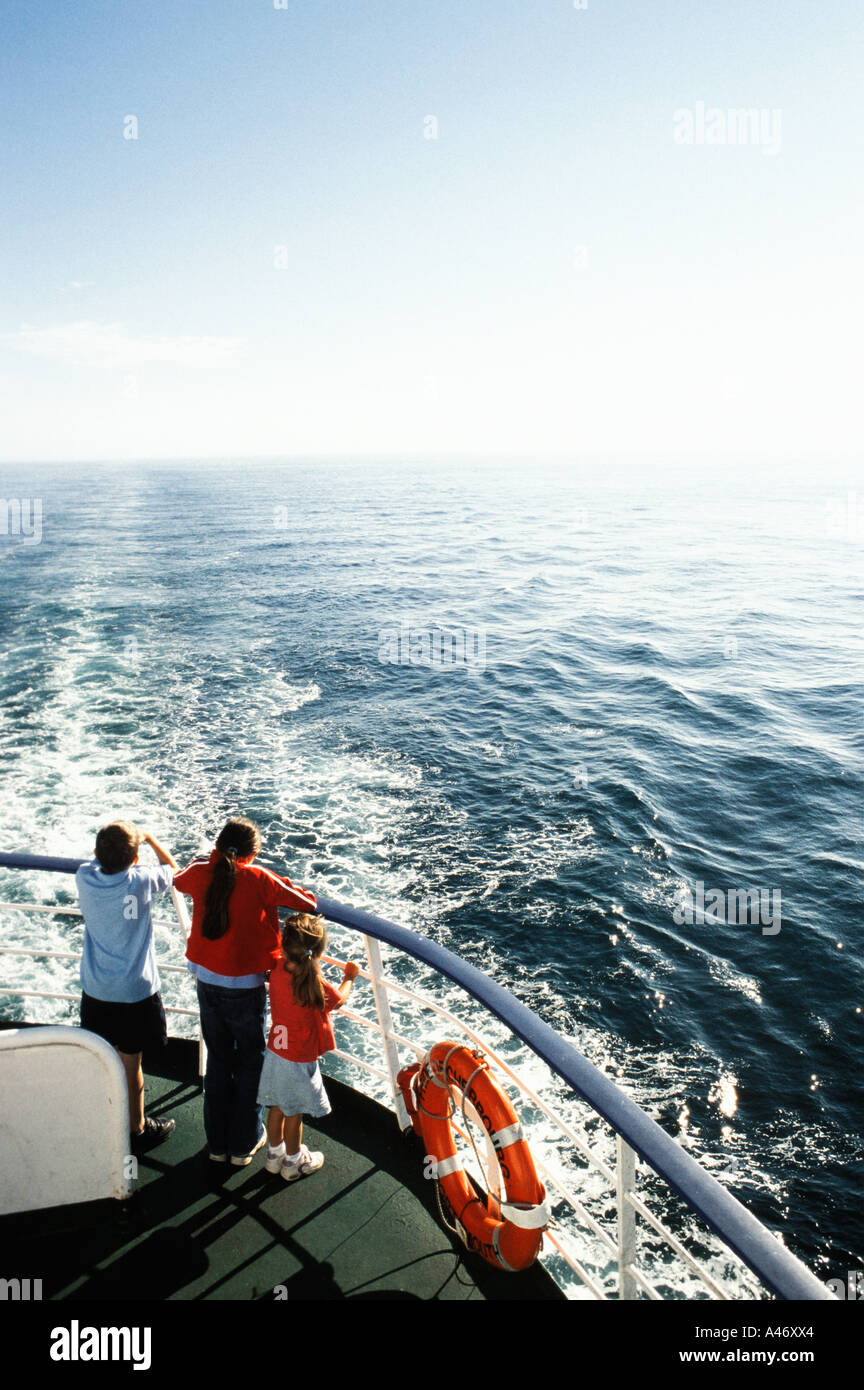 Three children on a ferry boat Stock Foto