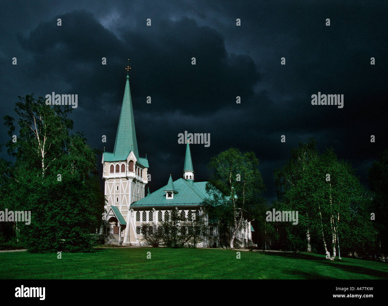 dramatic-black-clouds-gather-behind-a-traditional-wooden-church-in-A47TKW.jpg