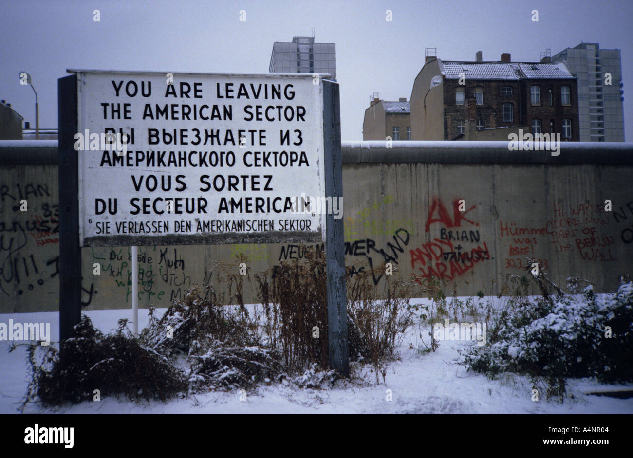 Berlin Wall in 1984. Sign you are leaving the American sector. Iron Curtain during the Cold War Stock Photo