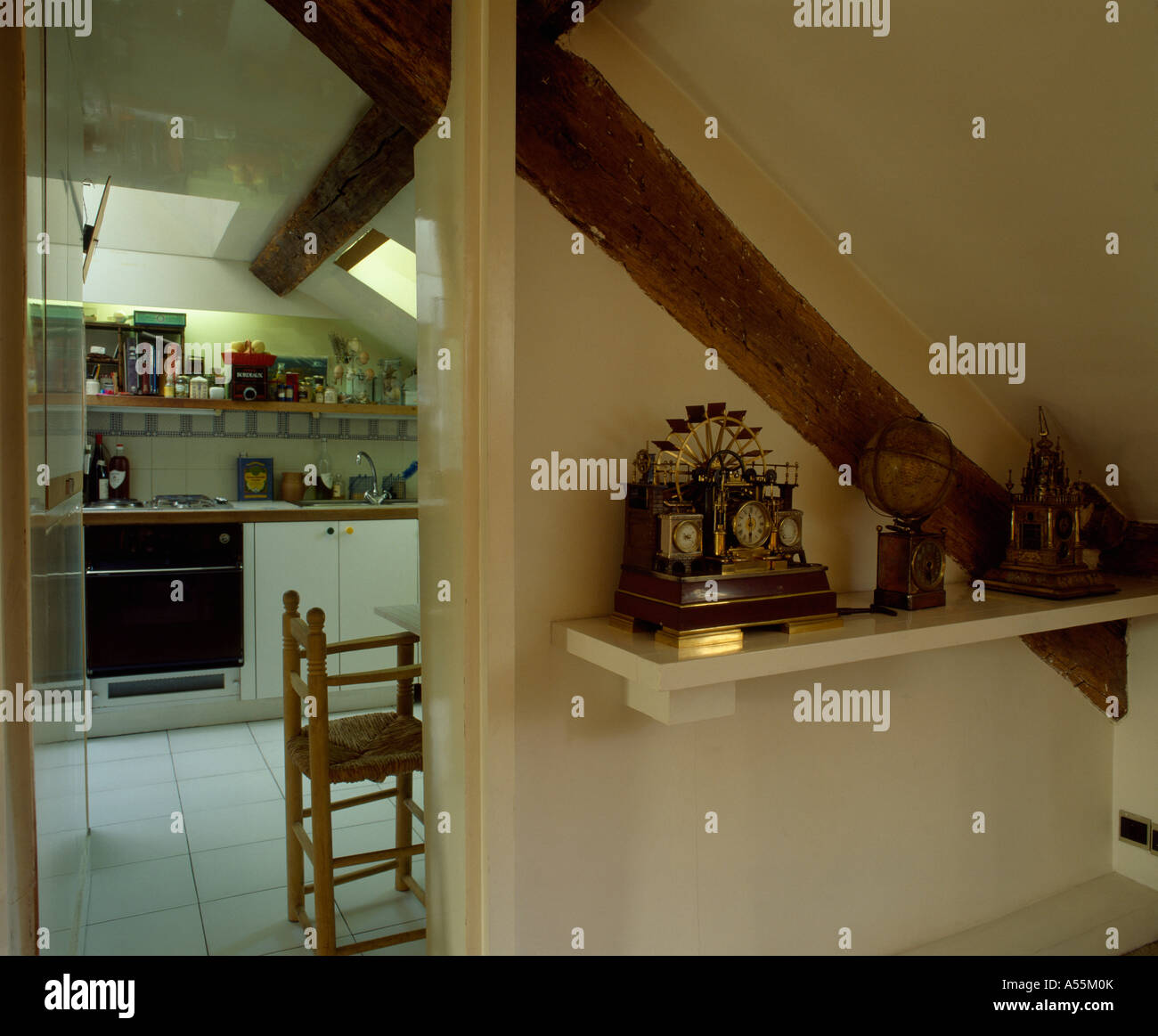 Attic Kitchen Shelf Beside Open Door To Modern White Attic Kitchen Stock Photo