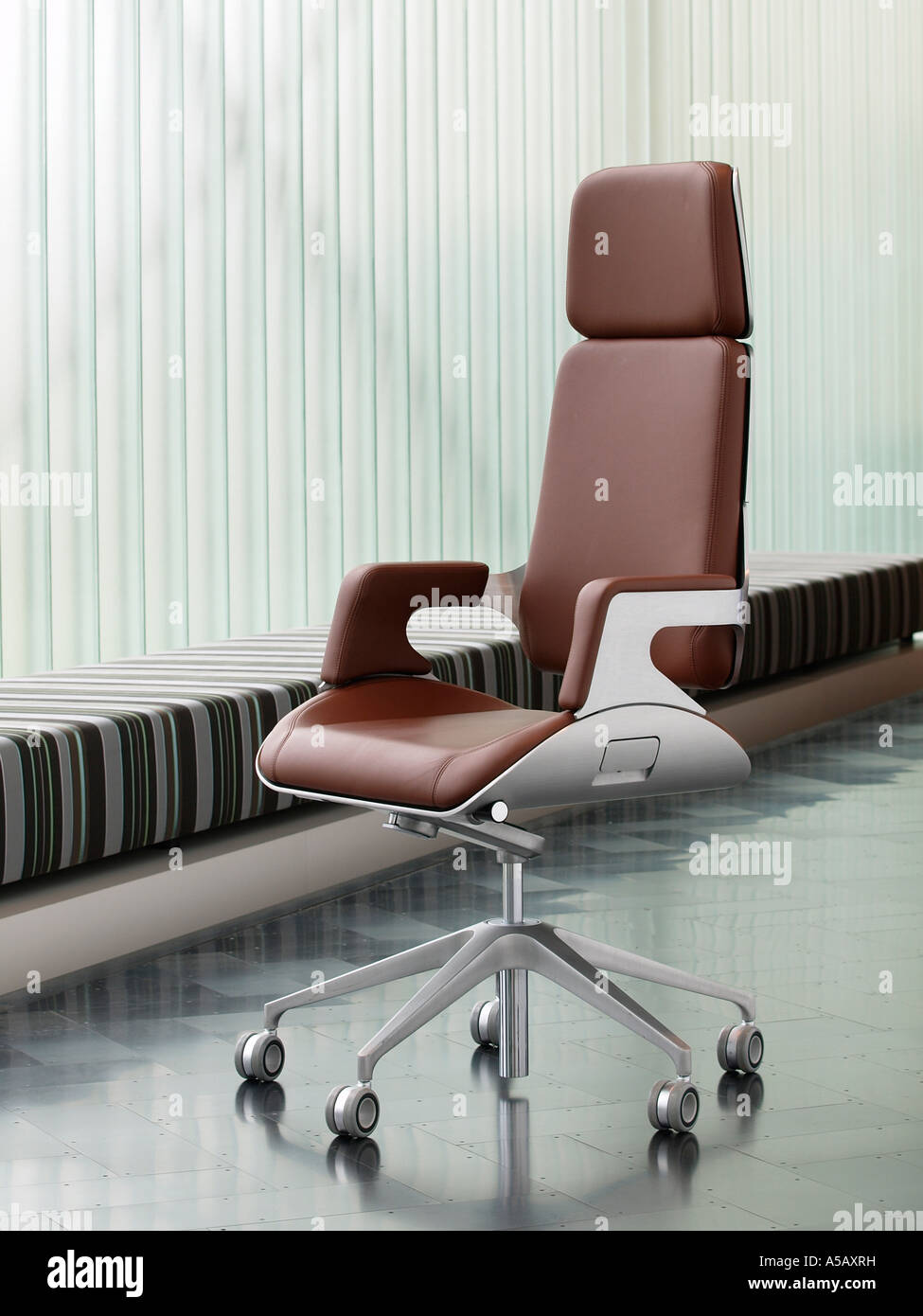 brushed metal and brown leather luxury office chair on. Black Bedroom Furniture Sets. Home Design Ideas