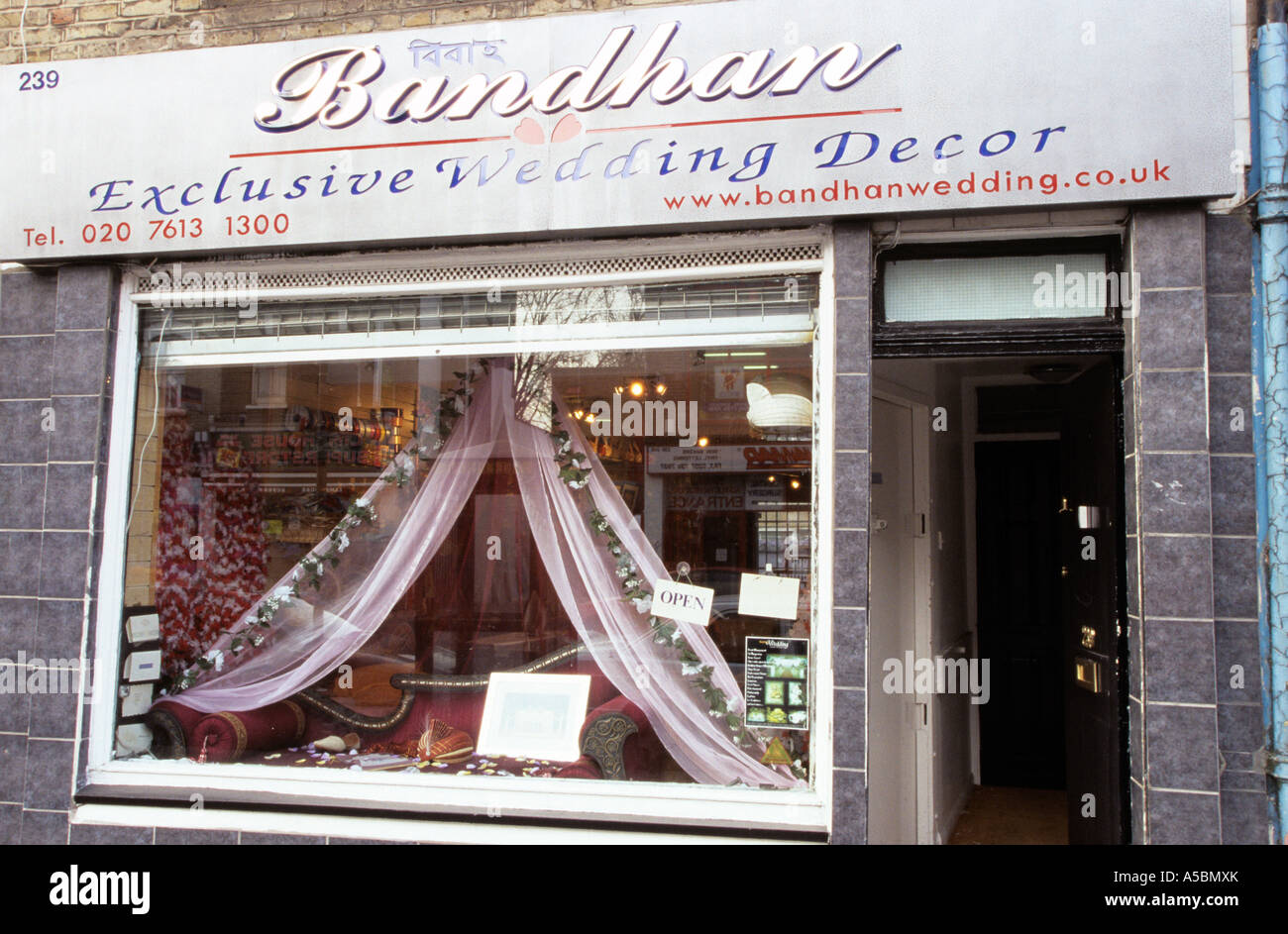 A window of a shop selling exclusive wedding decor in for Wedding decoration shop