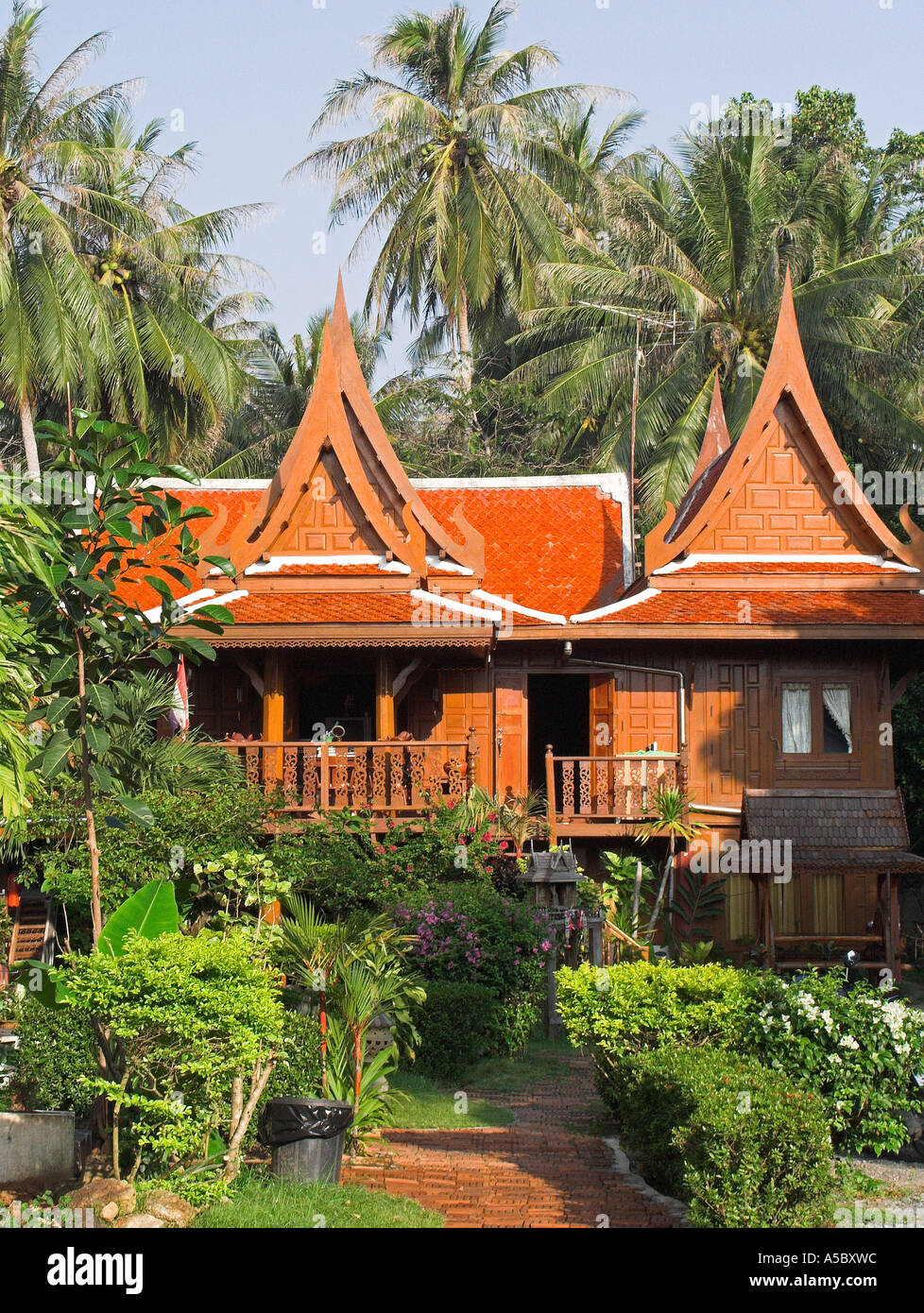 Traditional Carved Wood Two Storey Thai House And Garden