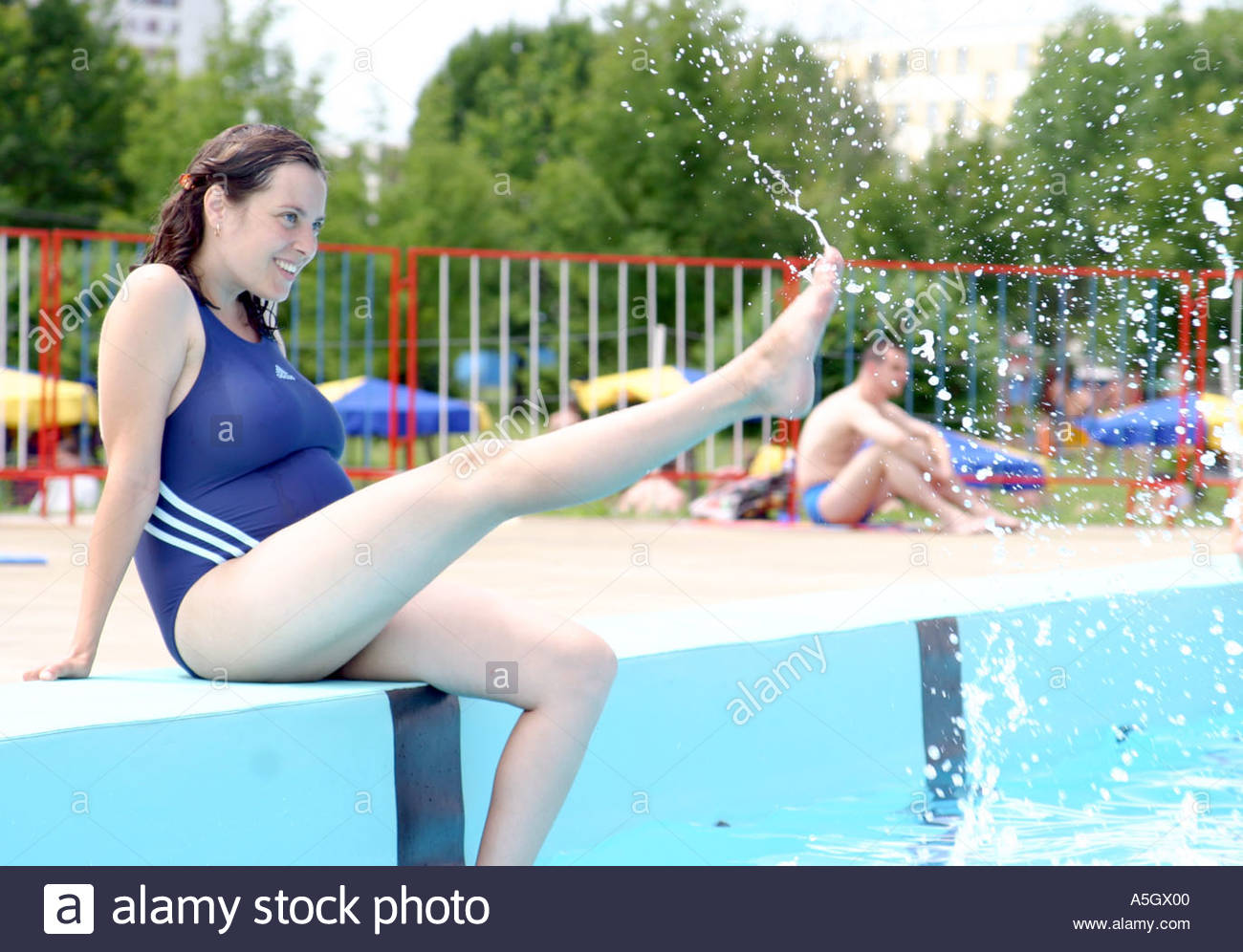 pregnant young woman by the swimming pool stock photo 3693055 alamy