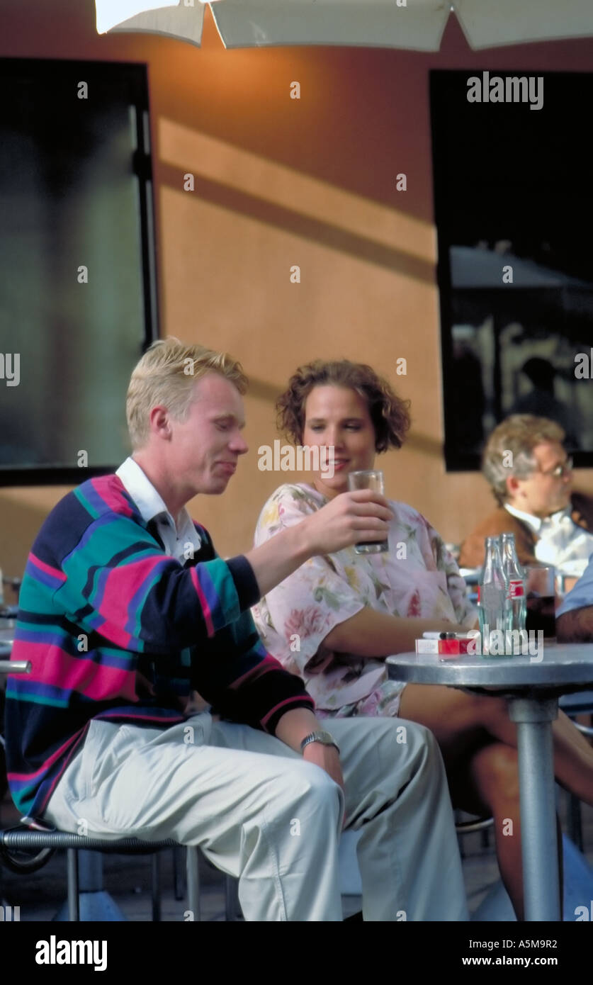 """Paris France, Young Tourist Couple, Sharing Drinks, Cafe Terrace in """"Les Halles"""" Fast Food Restaurant Stock Photo"""