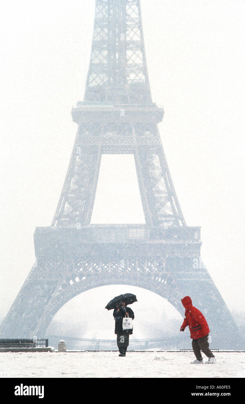"Tourists promenading in Winter, PARIS France, ""Eiffel Tower"" View from Trocadero in Snow Storm Child Cold Stock Photo"