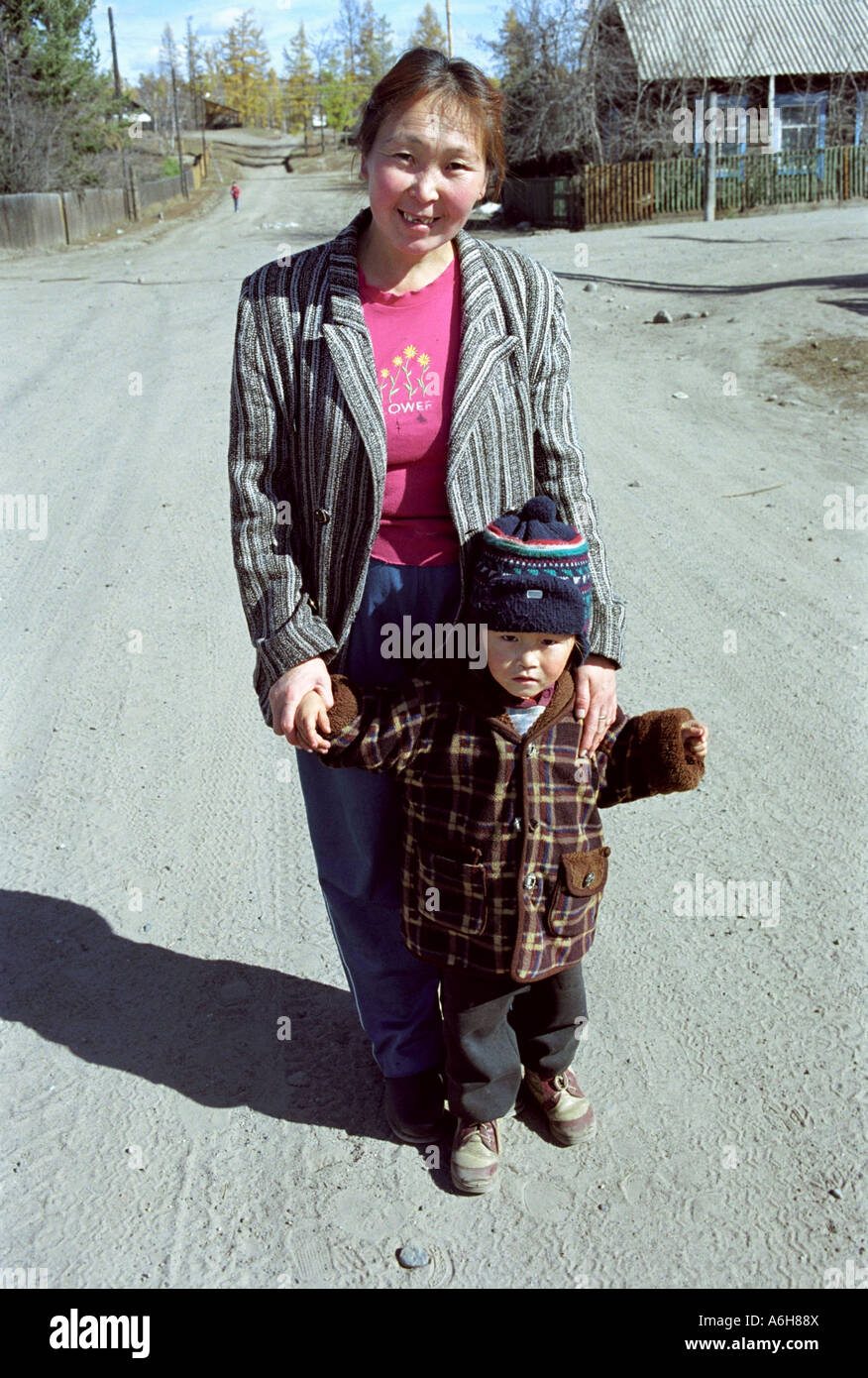 Portrait of a small girl with mother. Toora-Khem village. The Tyva (Tuva) Republic. Russia Stock Photo