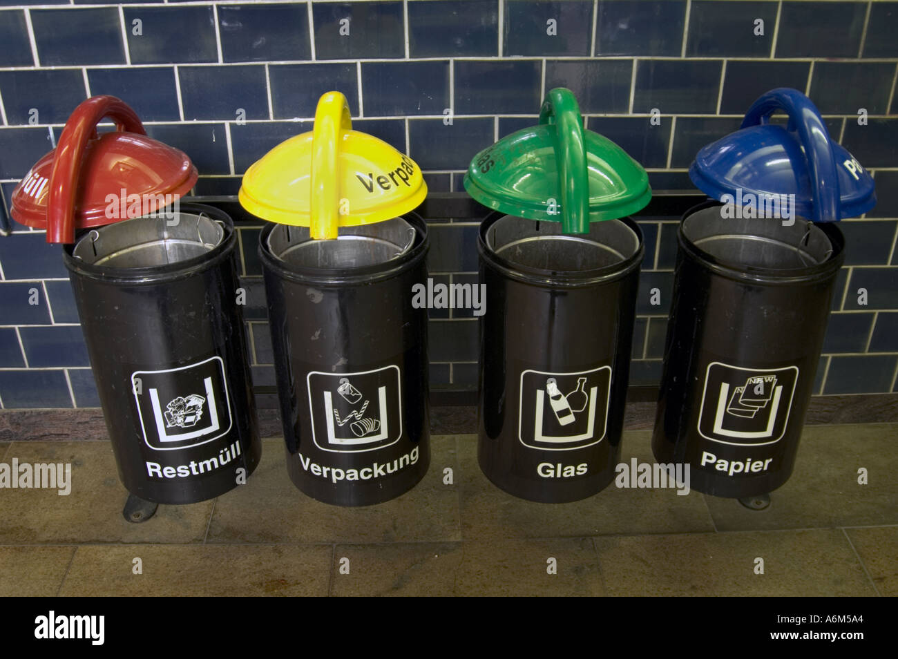 color coded public recycling bins in german train station berlin stock photo 2147747 alamy. Black Bedroom Furniture Sets. Home Design Ideas