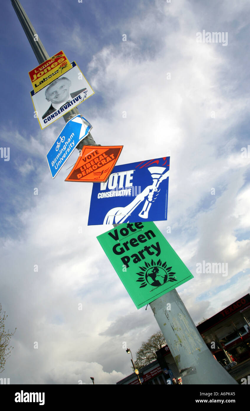 an-array-of-election-signs-on-a-lamp-pos