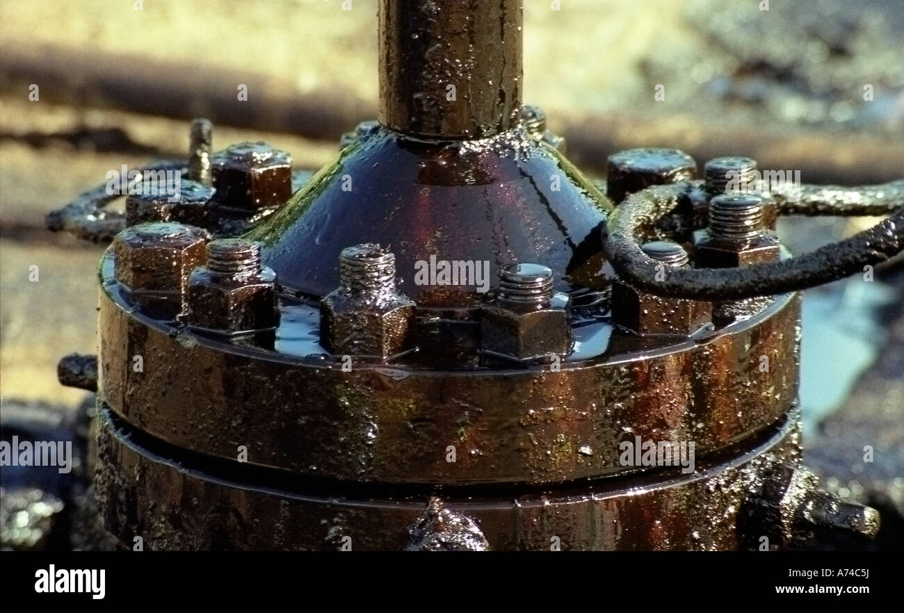 Flange Leak Wire : Flange of on an oil well with a leak stock photo royalty