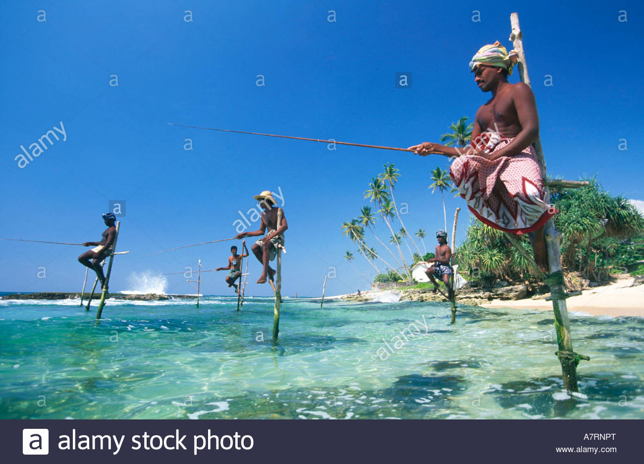 Fishermen fishing on beach against sky Sri Lanka Stock Foto