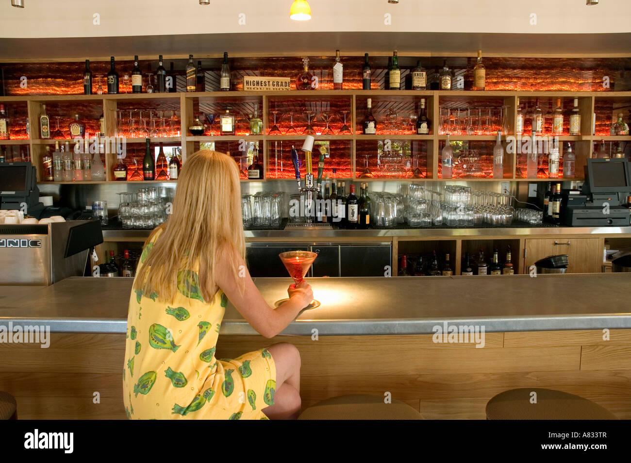 Woman Drinking Alone At Bar At Sedona Rouge Hotel Sedona