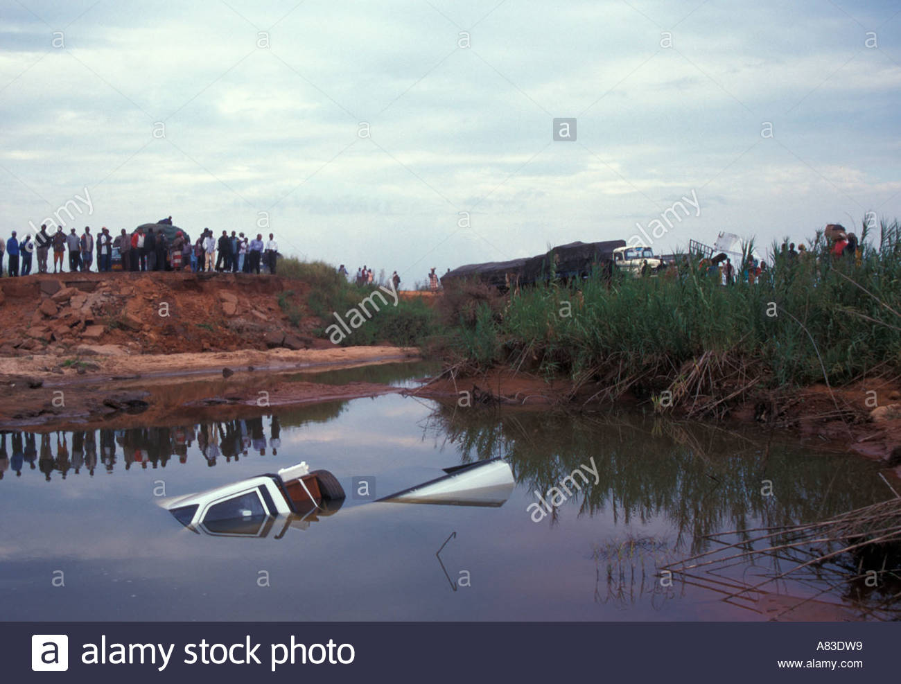 submerged-truck-after-floods-caused-by-hurricane-eileen-xai-xai-highway-A83DW9.jpg