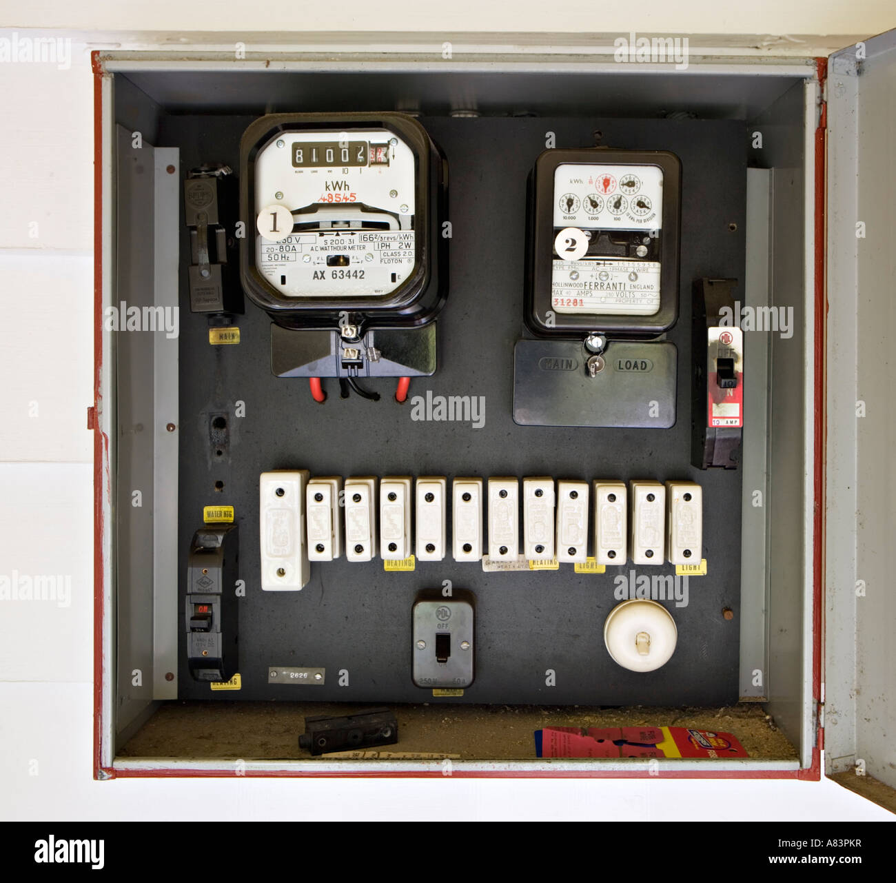 electricity meter in box with old style fuses  circa 1962