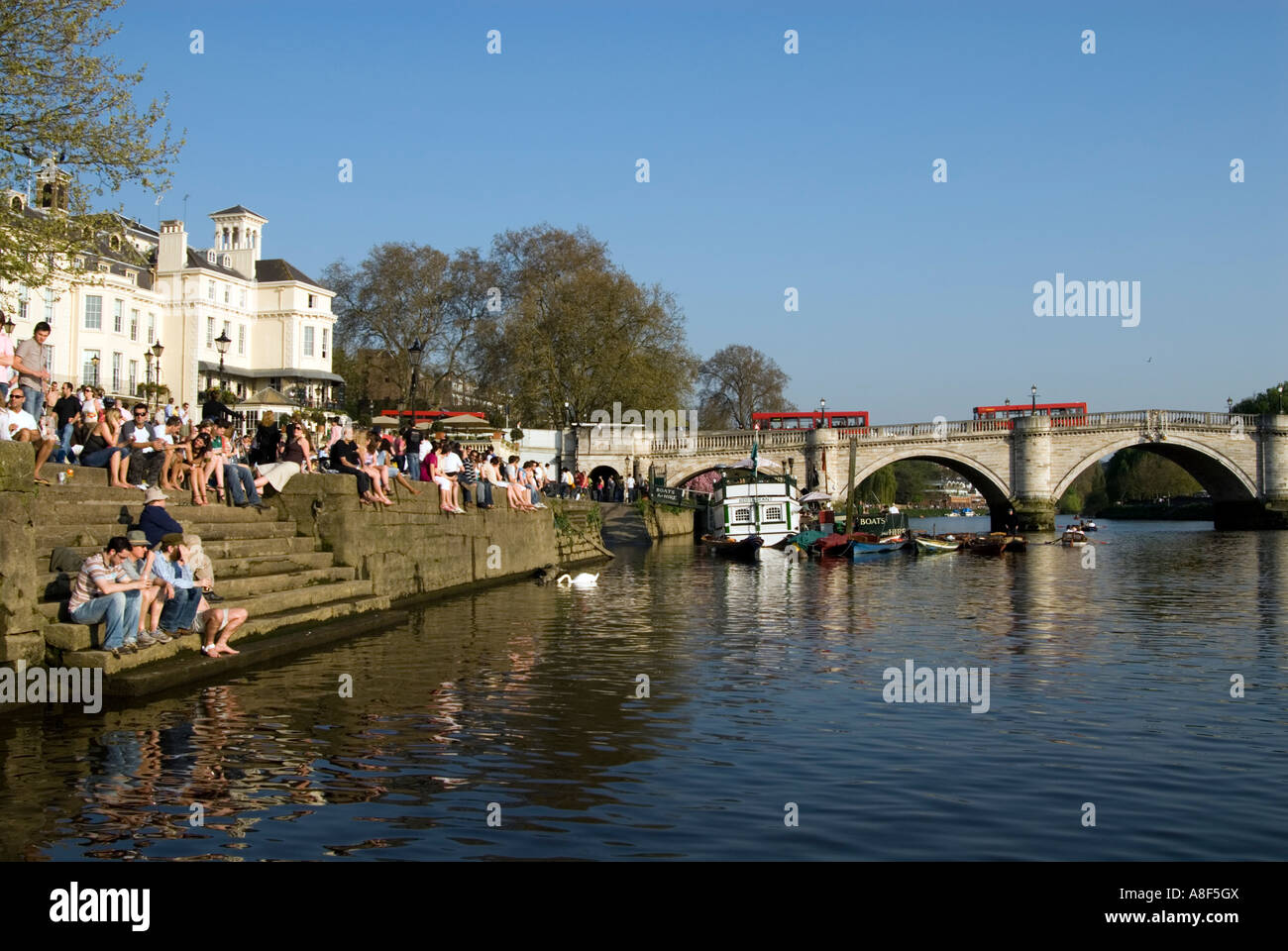 People relaxing on the riverside of the river thames for The riverside