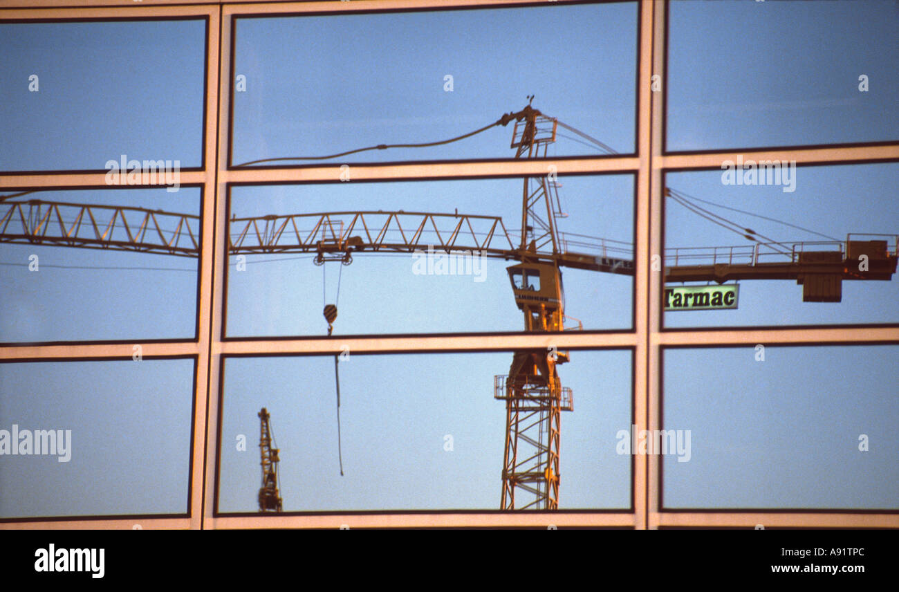 PICTURE CREDIT DOUG BLANE Tarmac crane on building site reflected in the glass building at Central Milton Keynes Stock Photo