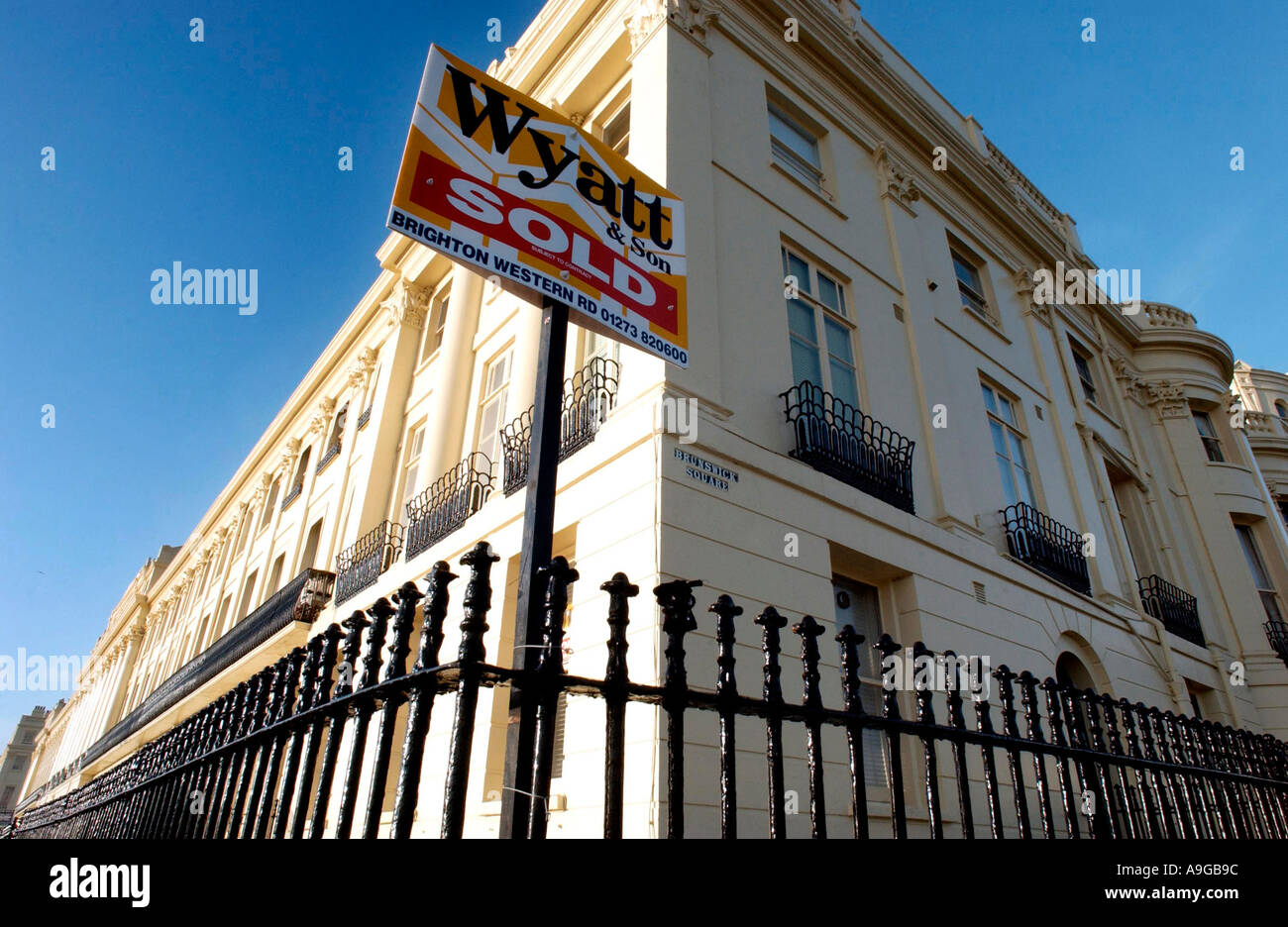 House sold sign on a period home in Brunswick Terrace, Hove Sussex Stock Photo