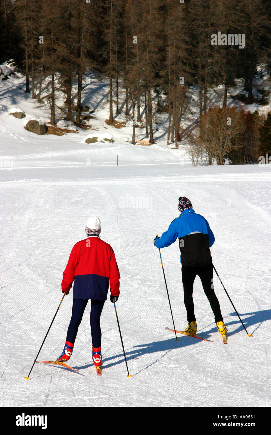 Cross country skiing on a frozen lake near St Moritz ...