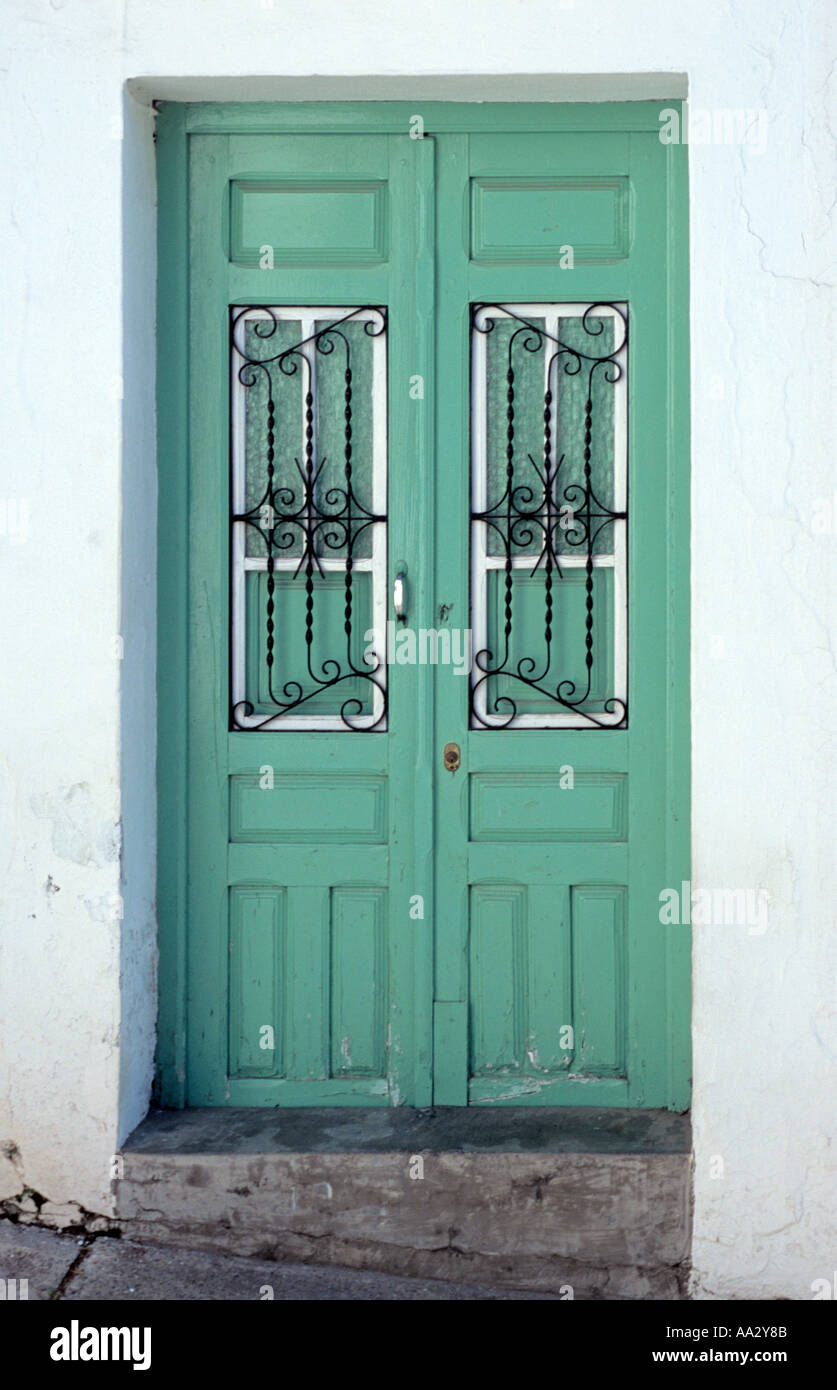 Traditional spanish door painted light turquoise with for Door in spanish