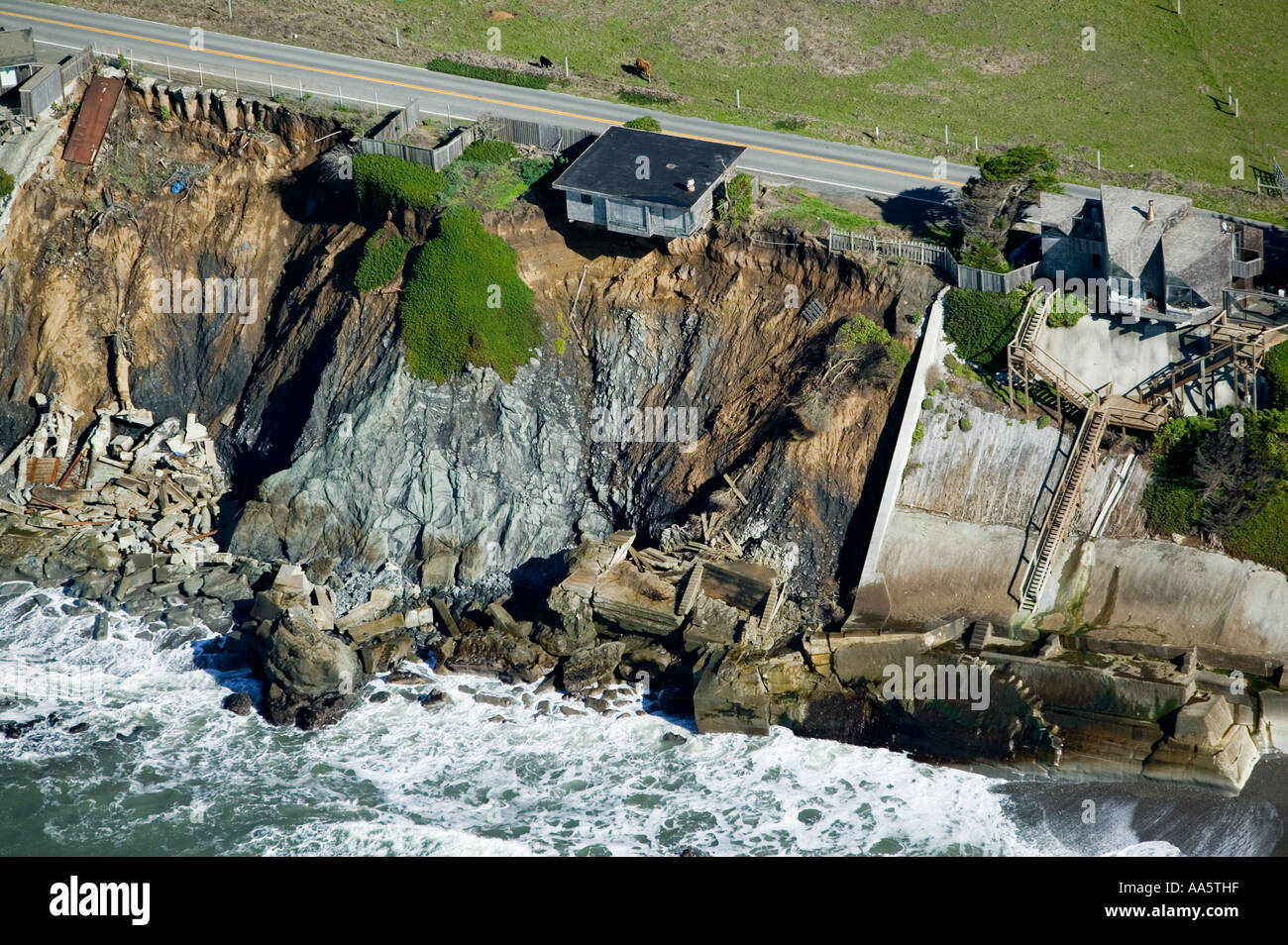 aerial above house ready to fall into the Pacific Ocean along Highway One in Sonoma County, California Stock Photo