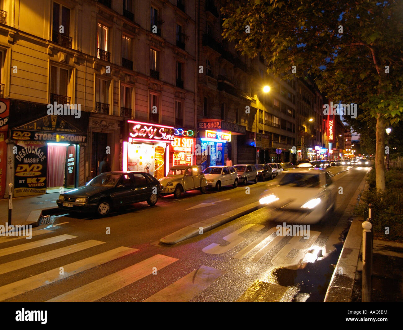 the boulevard de clichy in montmartre paris france has many sex shops stock photo royalty free. Black Bedroom Furniture Sets. Home Design Ideas