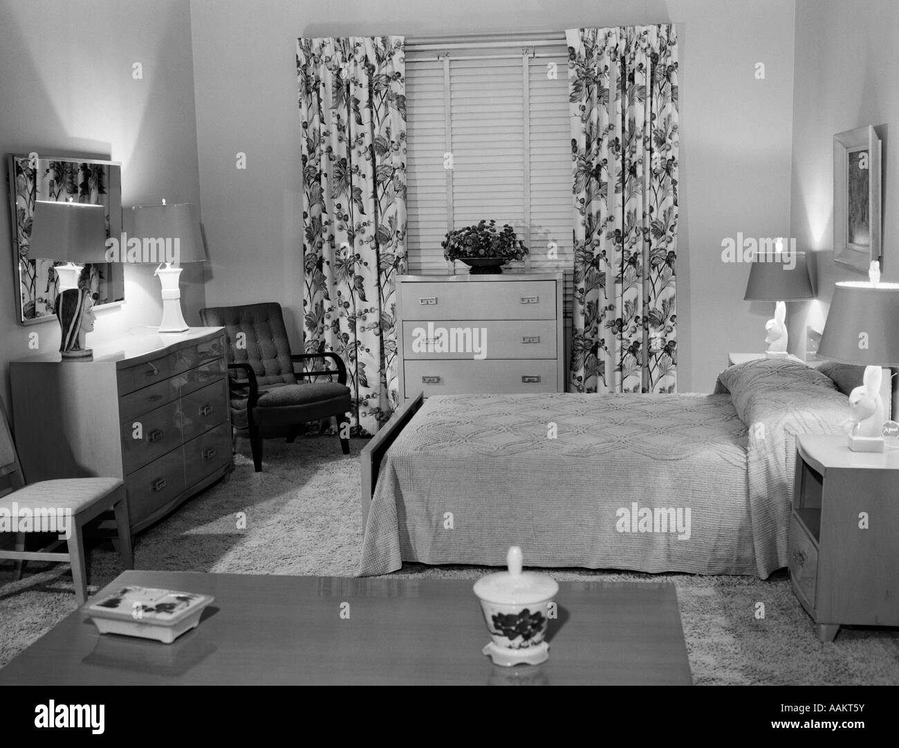 1950s bedroom interior with floor length floral curtains venetian