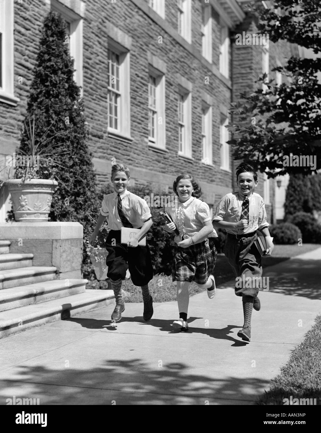 1940s GROUP OF THREE SCHOOL CHILDREN 2 BOYS 1 GIRL RUNNING ...