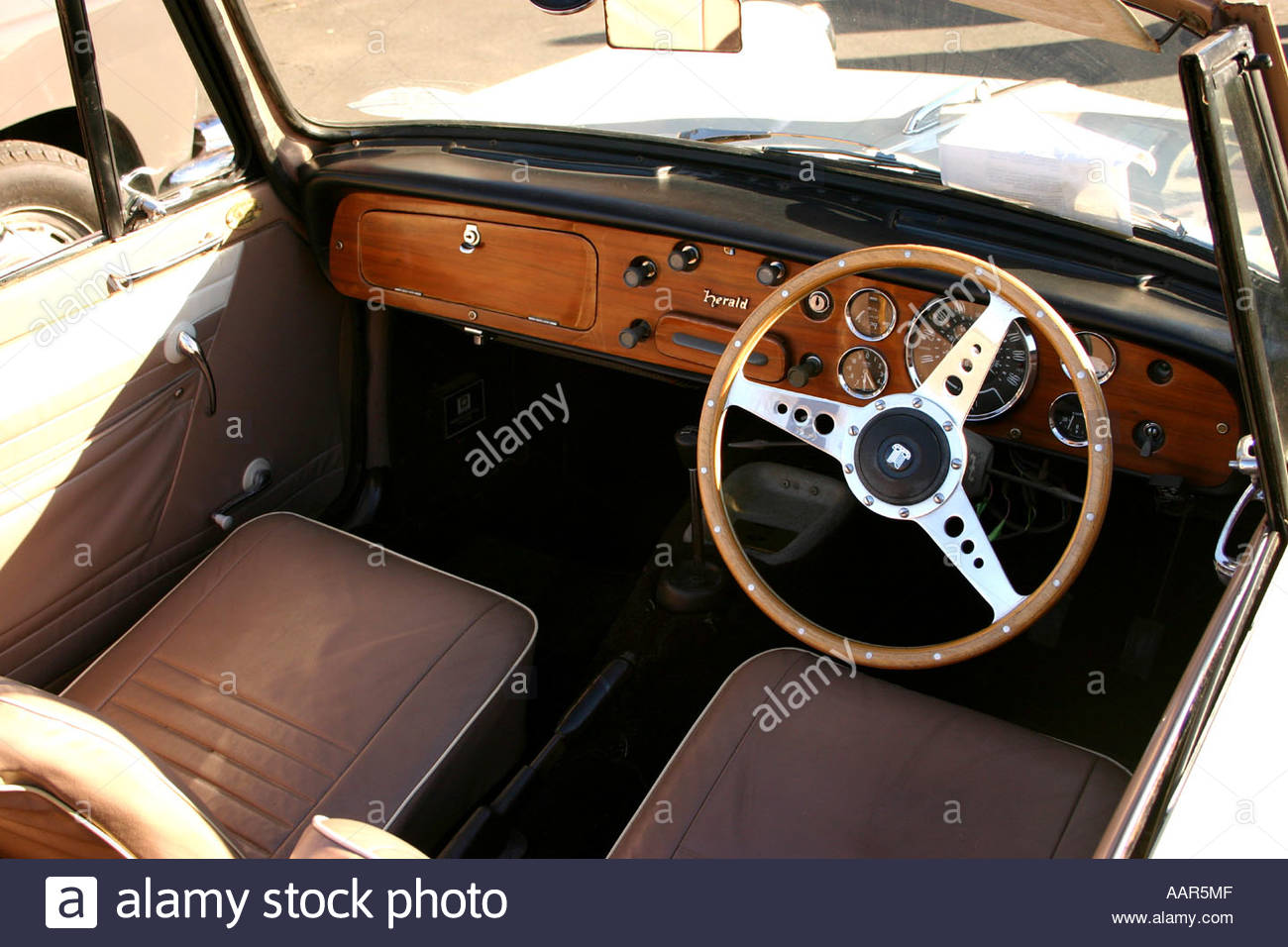 1960 triumph herald convertable interior classic car on display at stock photo royalty free. Black Bedroom Furniture Sets. Home Design Ideas