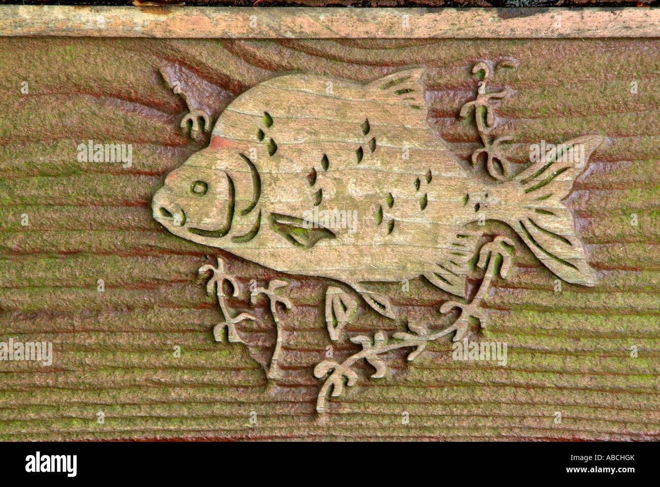 Bream fresh water fish wood grain carving symbol brown