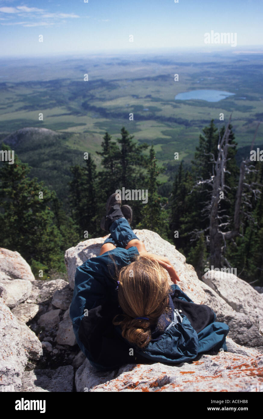 A hiker enjoys the view from Heart Butte peak along the Rocky Mountain Front Montana United States of America Stock Photo
