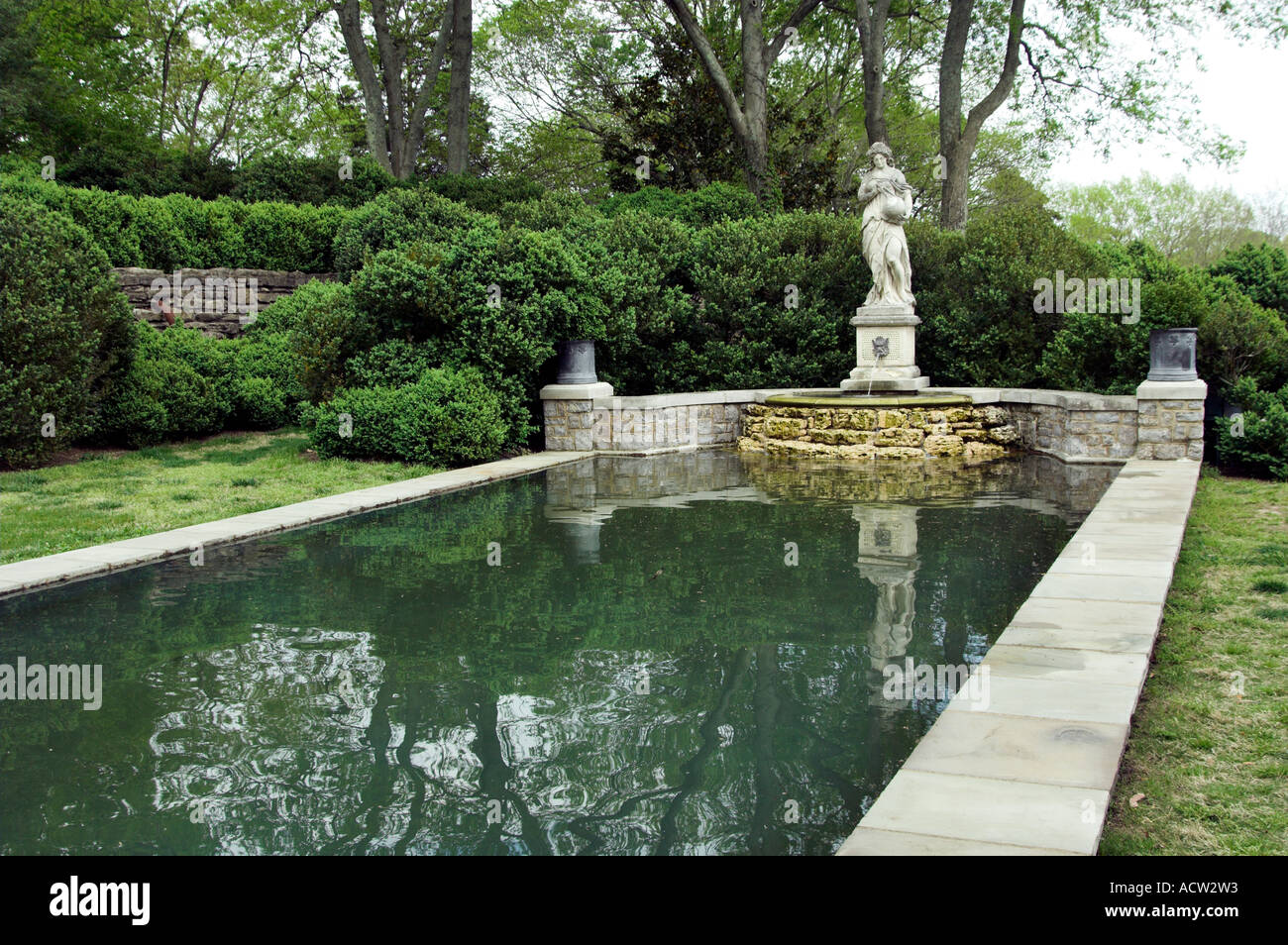 A reflecting pool and sculpture in the martin boxwood for Garden pool uk