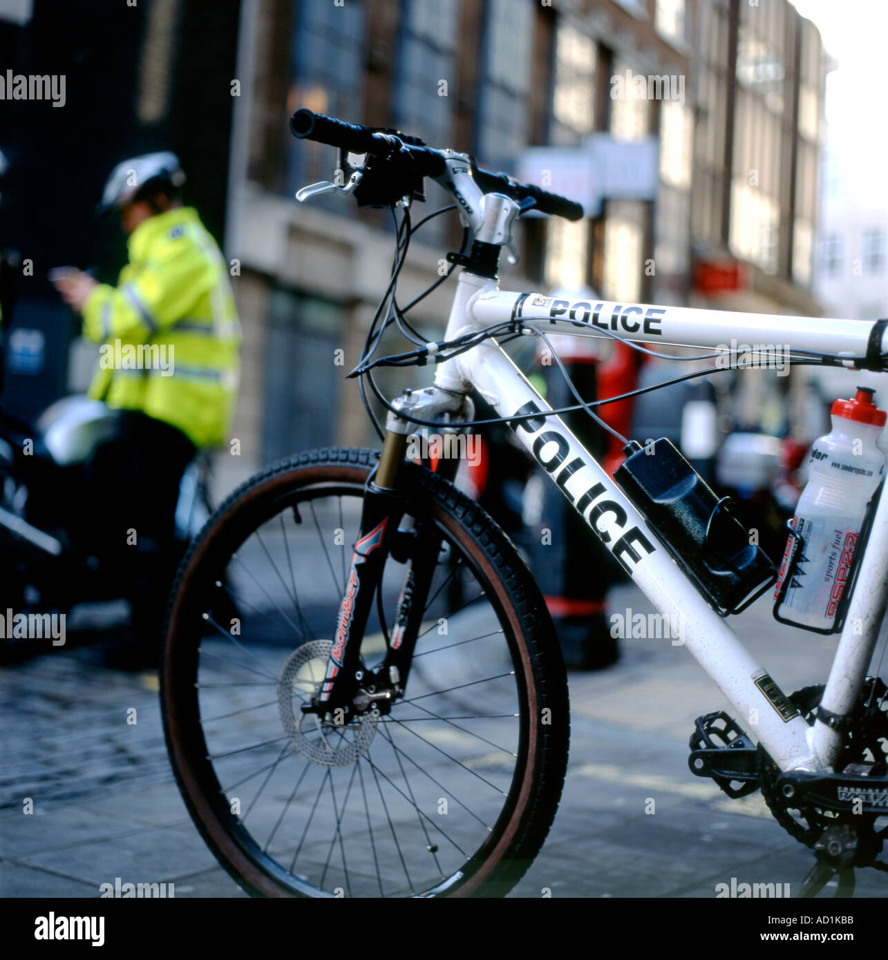 Police bicycle in London street with a policeman writing a ...