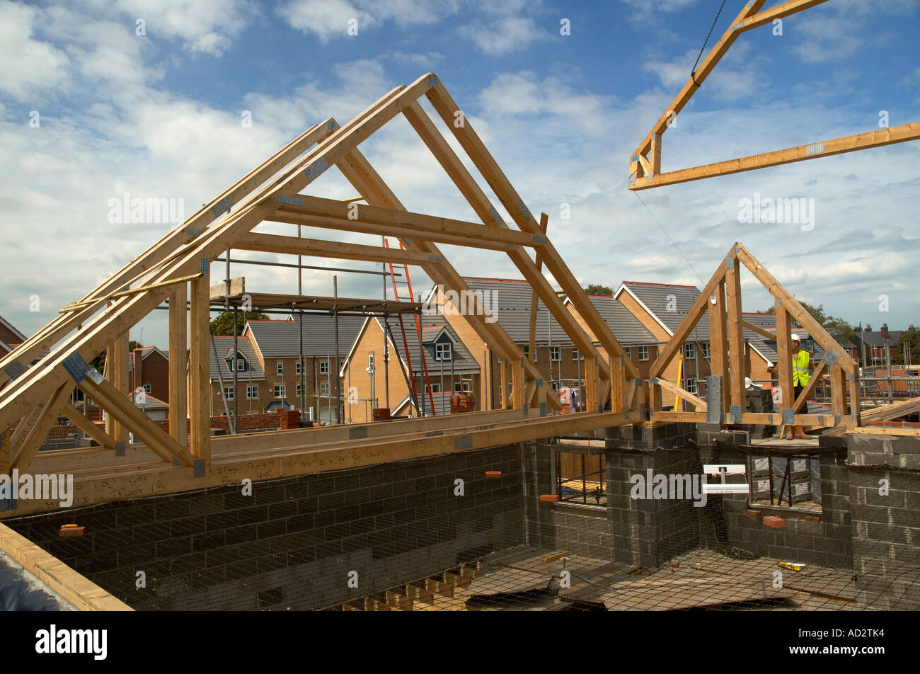 Pre fabricated roof trusses been erected on site stock for Pre manufactured trusses