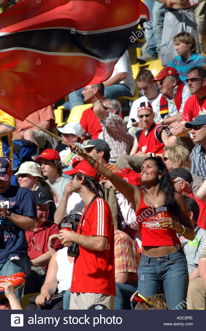 FIFA World Cup 2006 Sweden vs Trinidad. Trinidad and Tobago supporters. A young lady waves her flag with abandon Stock Photo