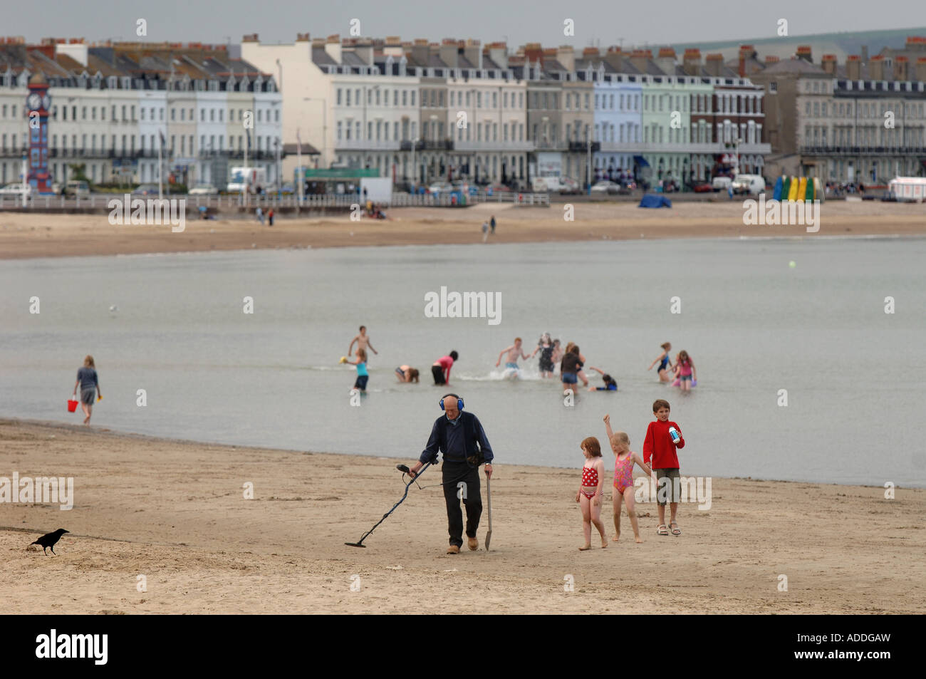 Jew Detector: A Man With A Metal Detector Walking Up And Down The Beach