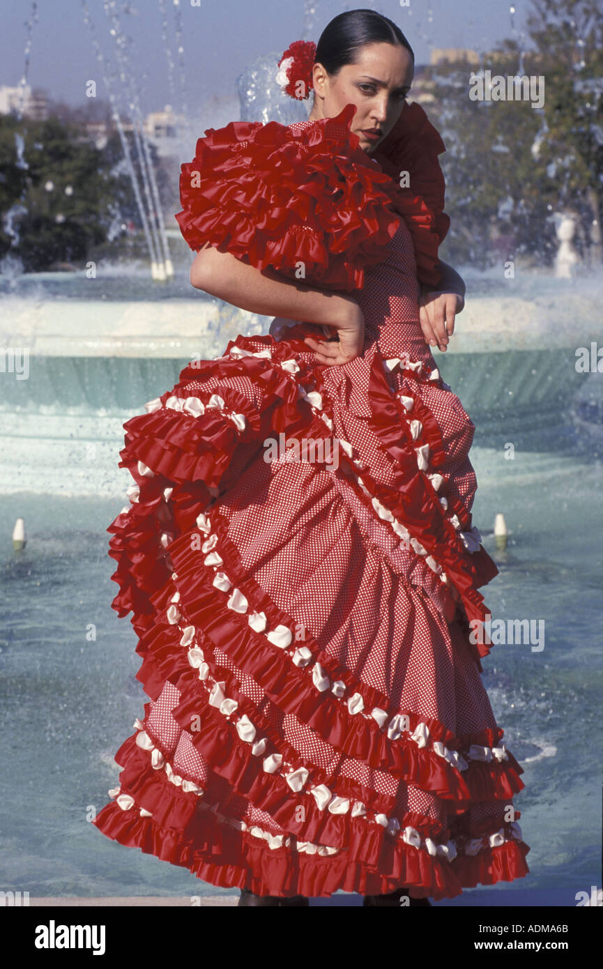 Seville Fashion: Spanish Young Woman Dressed In Sevillana Traditional