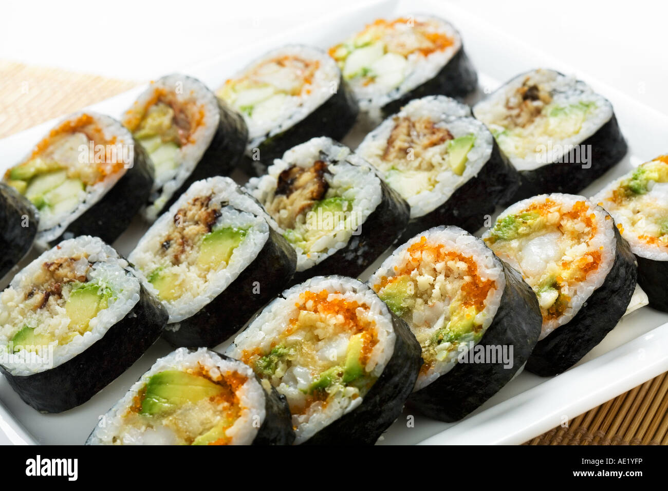A Japanese dish consisting of sushi rolls on a serving plate. Stock Photo