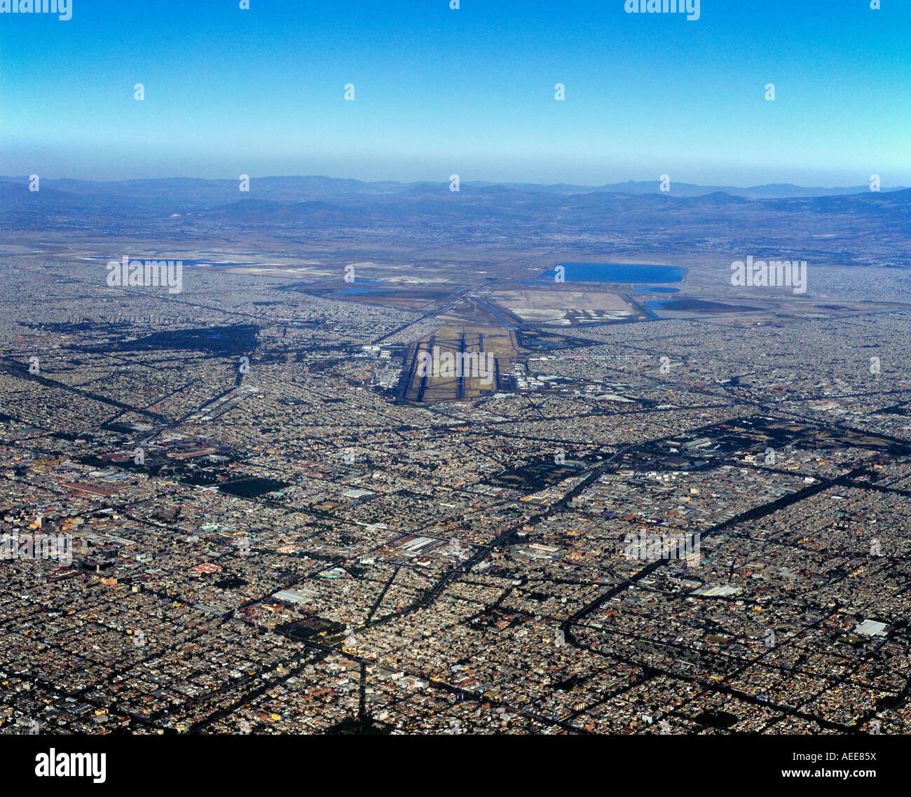 aerial overview above Mexico City from the south toward Benito Juarez international airport Stock Photo