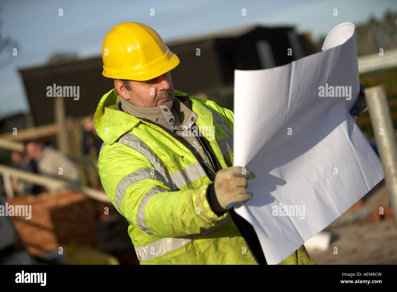 Construction Worker With Hi Vis Clothing And Hard Hat