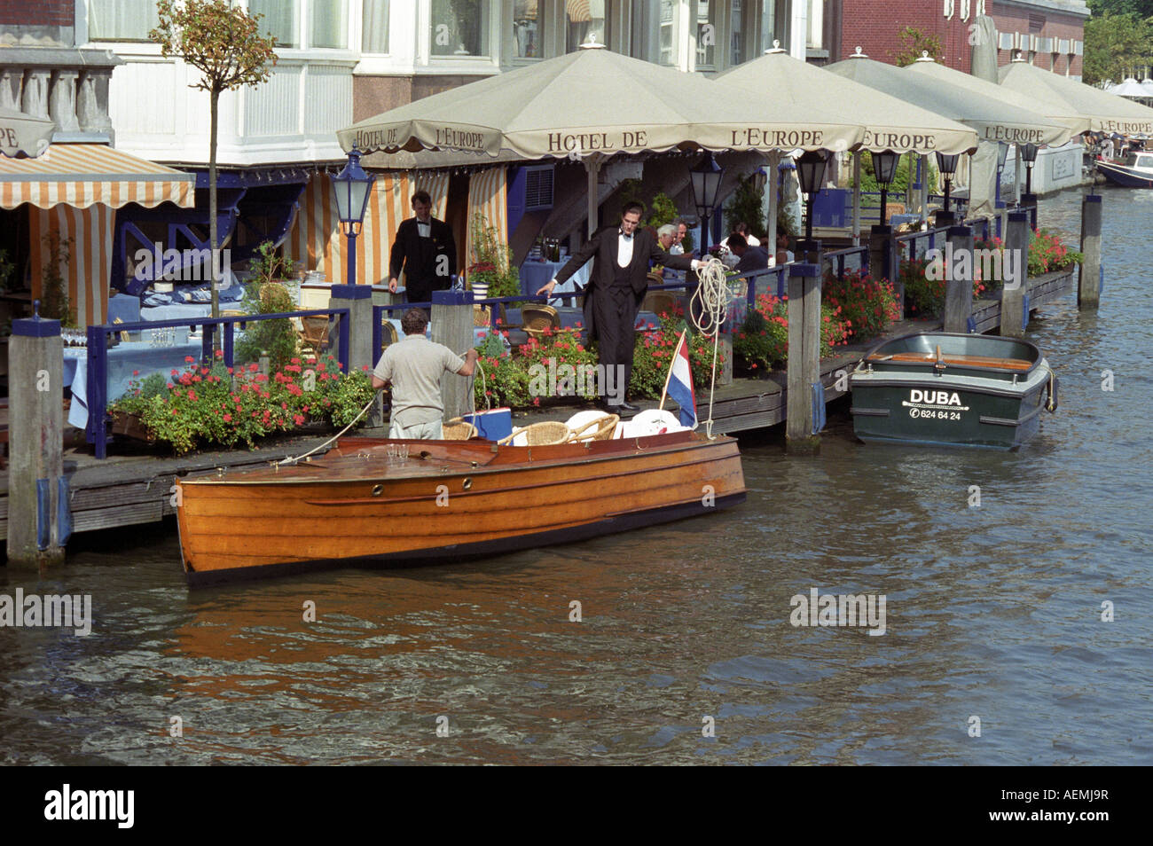 Wooden Boat An Amsterdam Canal In Front A Hotel And