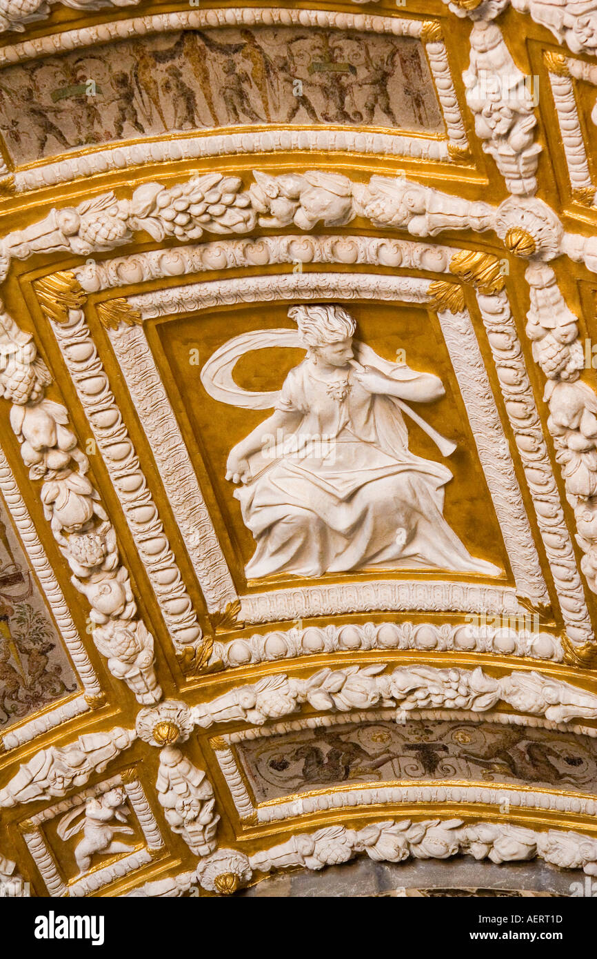 Gold leaf and bas relief sculptures on arched ceiling of