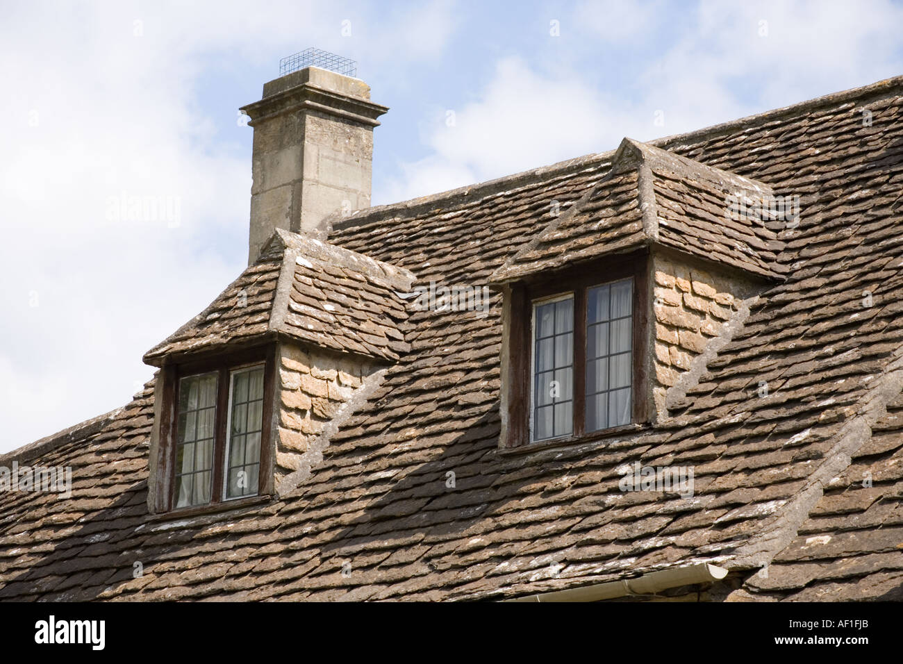 Dormer Windows In A Cotswold Stone Roof On A Cottage At