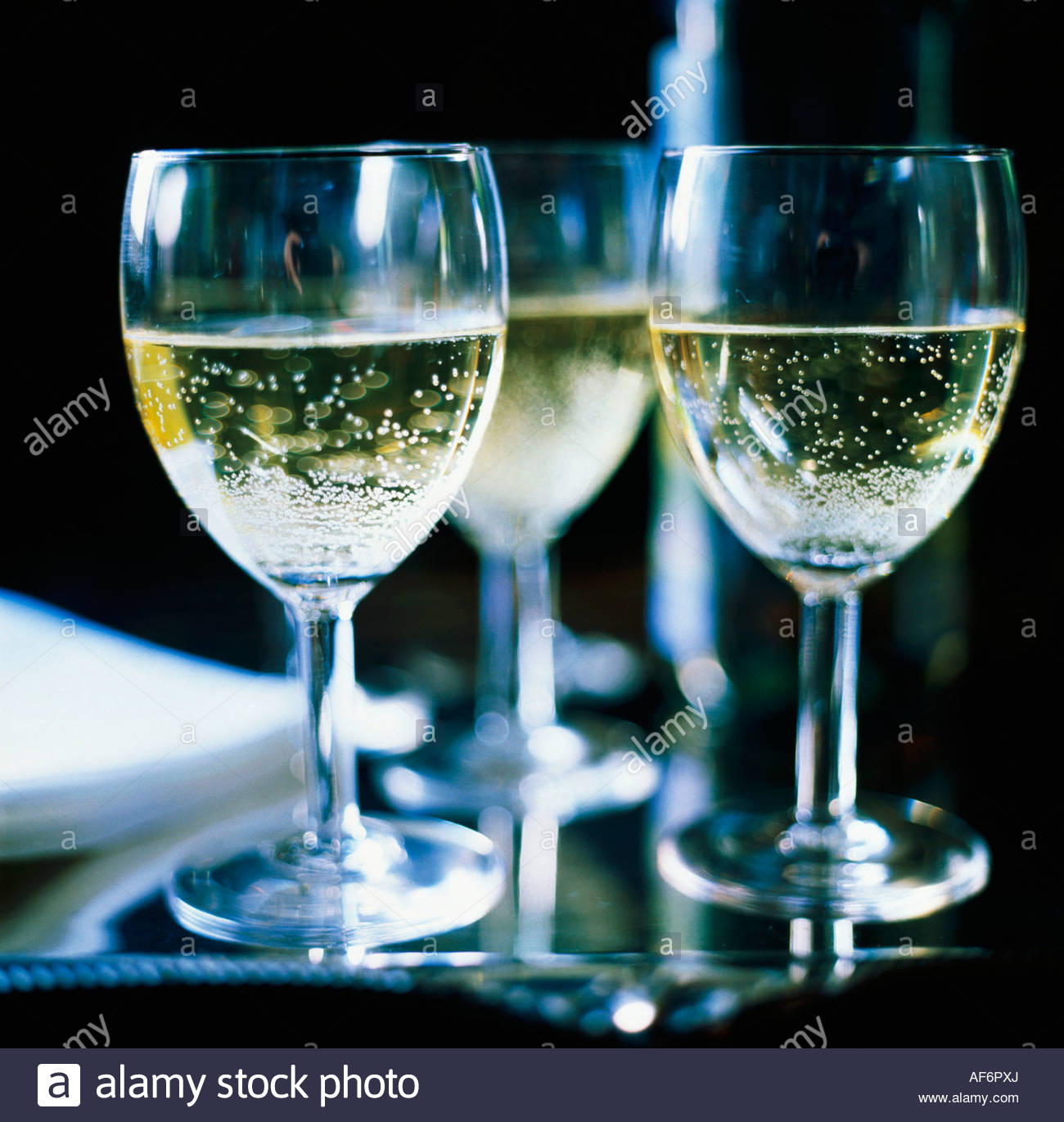 three-glasses-of-sparkling-white-wine-AF