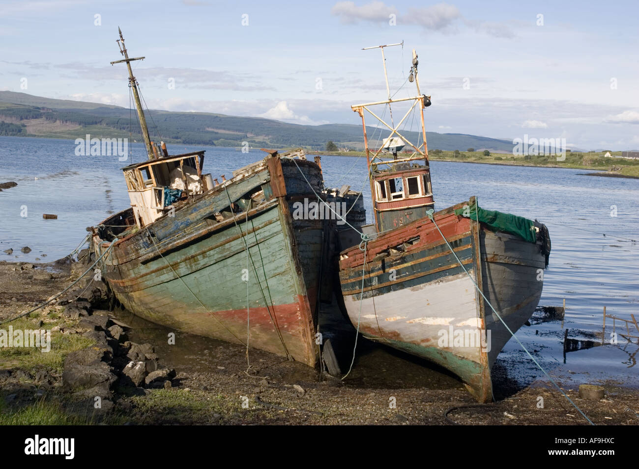 Old fishing boats rotting on beach isle of mull scotland for What to do with an old boat