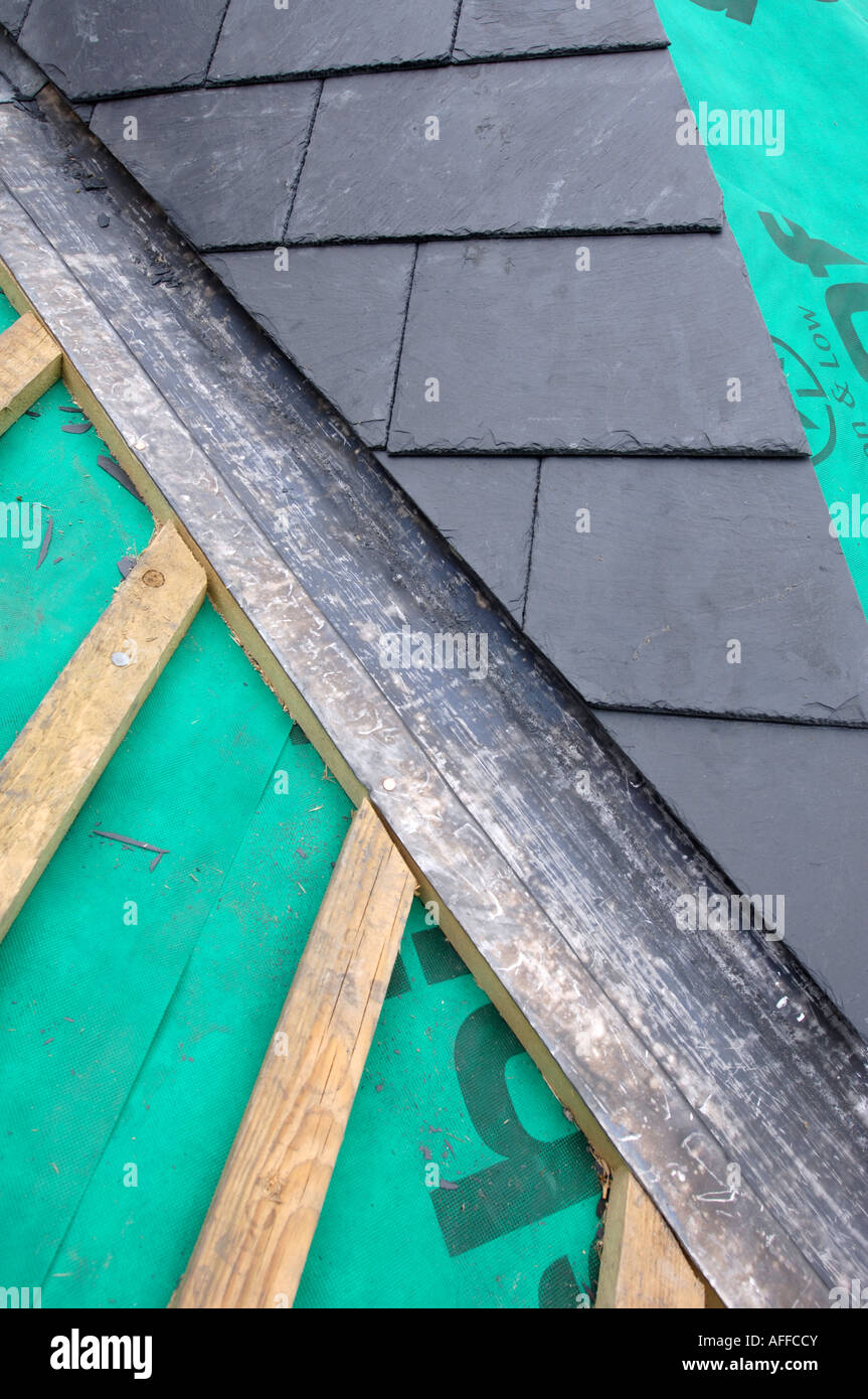 The Section Of A Slate Roof Under Construction Showing The