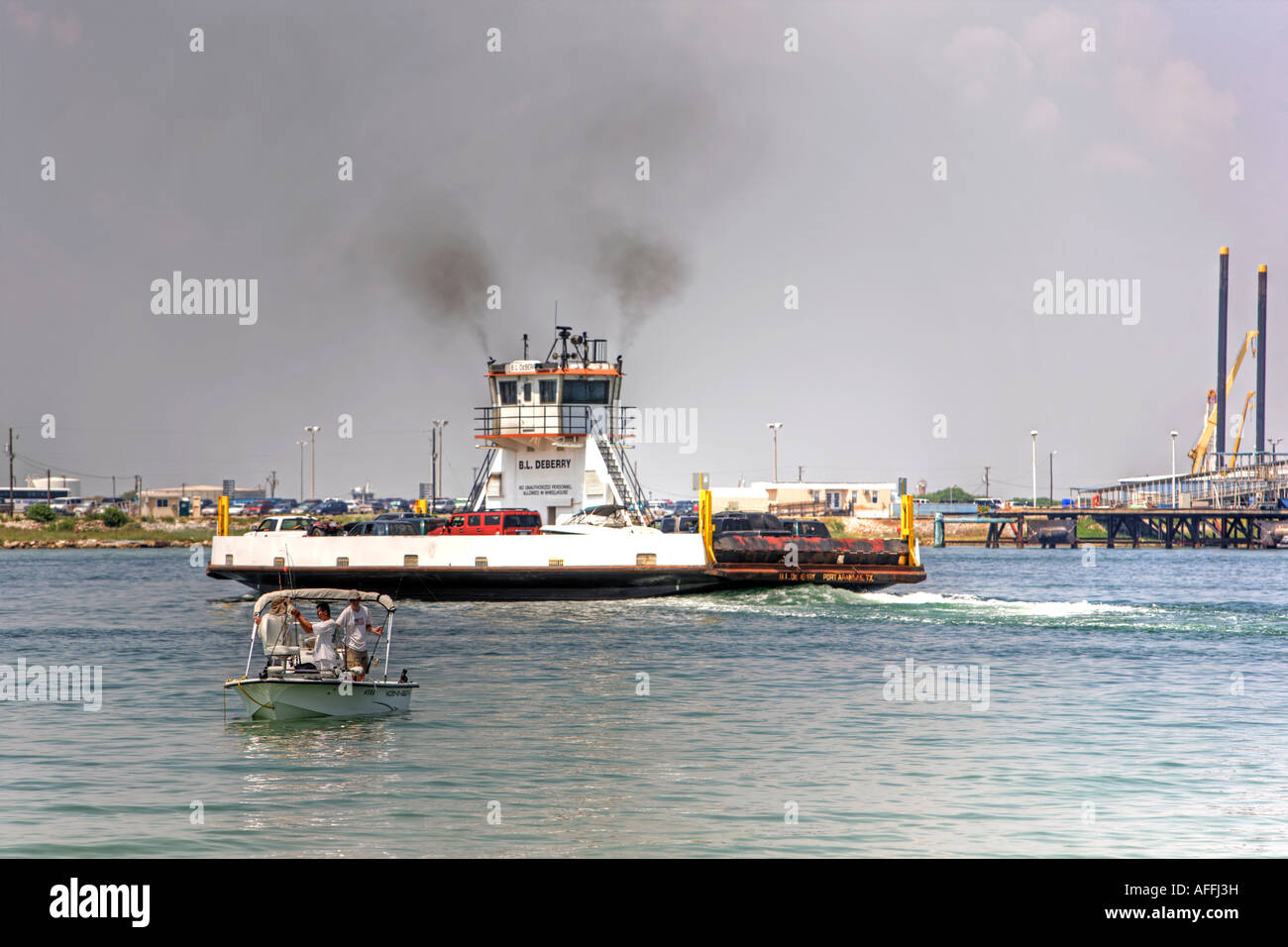 Ferry boat in channel with fishing boat port aransas on for Fishing in port aransas