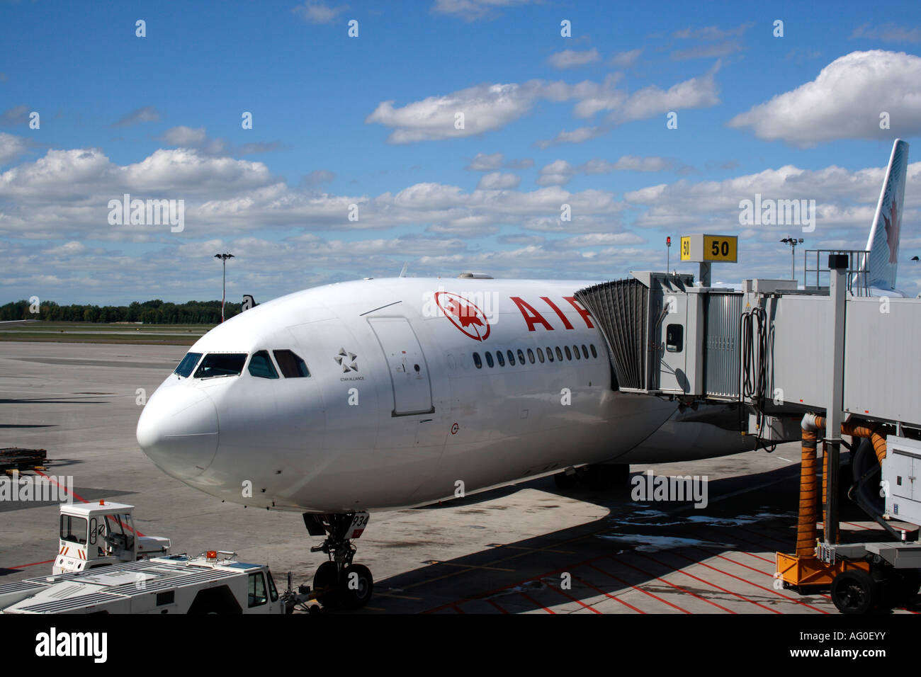 air canada plane on ground with walkway at the airport of montreal stock photo royalty free. Black Bedroom Furniture Sets. Home Design Ideas