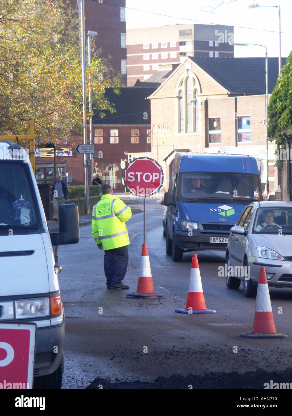 What Are My Rights During A Traffic Stop >> Manual Traffic Control During Roadworks. A Man Operating A Stop/go Stock Photo, Royalty Free ...