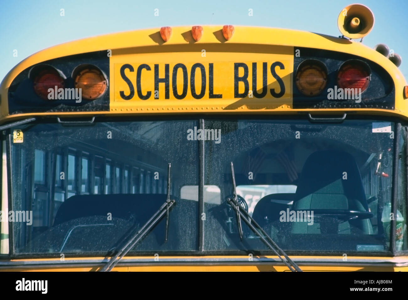 A Head On Up Close View Of A Bright Yellow School Bus